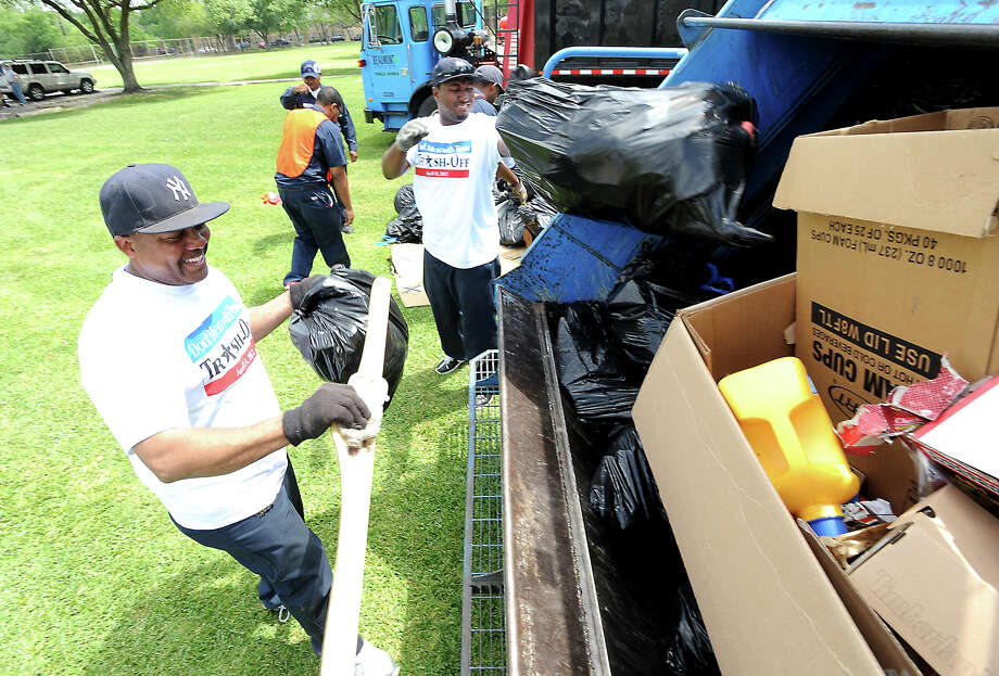 "Volunteers dump trash in a sanitation truck at Sprott Park during the city wide ""Trash-Off"" in Beaumont, Saturday, April 14, 2012. Tammy McKinley/The Enterprise Photo: TAMMY MCKINLEY"