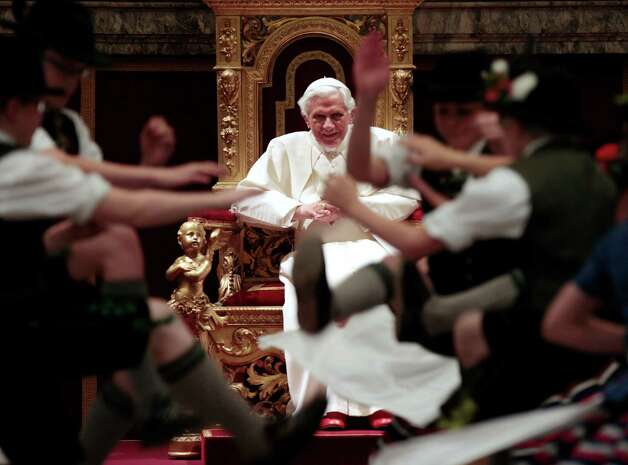 Pope Benedict XVI watches dance of children in Bavarian costumes at his 85th birthday last April.  A visibly frail Benedict is abdicating as Pope on Feb. 28.  A conclave of cardinals in Rome will pick his successor. Photo: Gregorio Borgia, ASSOCIATED PRESS / AP2012