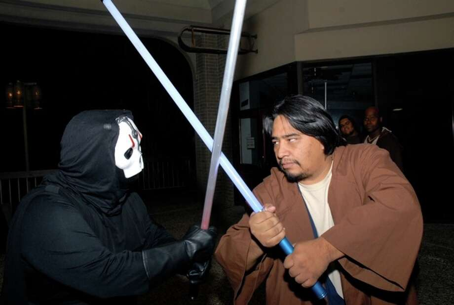 "Sith Shadow Council of Texas members John ""Mace Windu"" Runnels (right) and Ashley ""Darth Revenna"" Cerda face off during saber practice. Photo: Jason Olivarri/Southside Reporter"