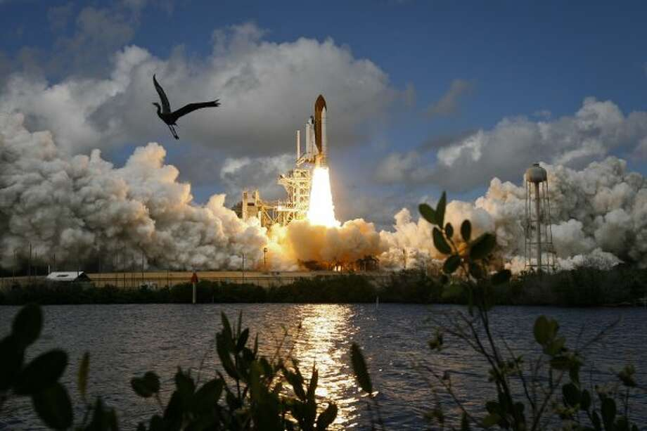 Discovery launches Oct. 23, 2007, at Kennedy Space Center. STS-120 including docking with the international space station.  (James Nielsen / Houston Chronicle)