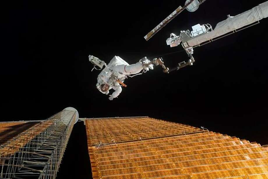 Astronaut Scott Parazynski repairs a damaged ISS solar panel during a spacewalk on STS-120 on Nov. 3, 2007. It was a risky procedure because of risk of electrocution. (Credit: NASA)