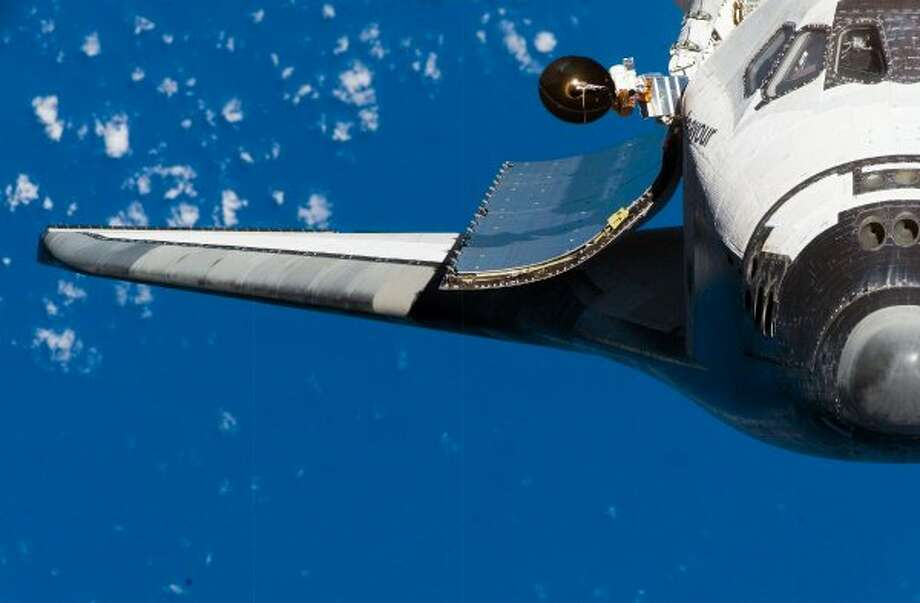 A close-up view of the exterior of space shuttle Endeavour's crew cabin, starboard wing and payload bay door was provided by the station's Expedition 16 crew.  (NASA / NASA)