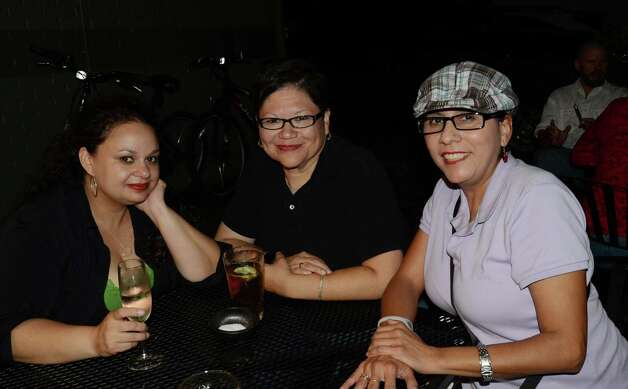 Frances Mejias (cq) (from left), Janie Rodriguez and Lydia Sanchez (cq) have a girls' night at the grand opening of Southtown 101 on April 6, 2012. Robin Johnson