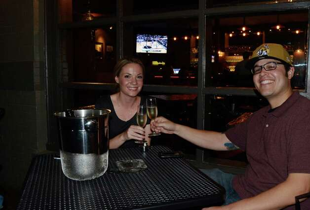 Ashley Wright and Eddie Ramero split a bottle of wine on the patio of Southtown 101 on April 6, 2012. Robin Johnson