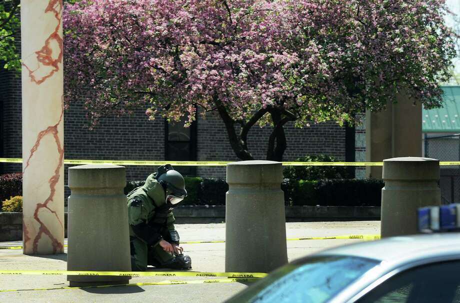 A suspicious package found in the courtyard of the Brien McMahon U.S. Federal Building and Courthouse at the corner of State Street and Lafayette Boulevard on Monday, April 16, 2012 was removed by federal authorities and state police. Authorities received a phone call at about 10:30 a.m. regarding the package. A short time later they taped off a section of the courtyard from the public and closed down a lane of traffic on State Street along the side of the building. The plastic bag was removed by a state police trooper wearing a blast suit around noon. The courthouse and building were never evacuated. Photo: Cathy Zuraw / Connecticut Post