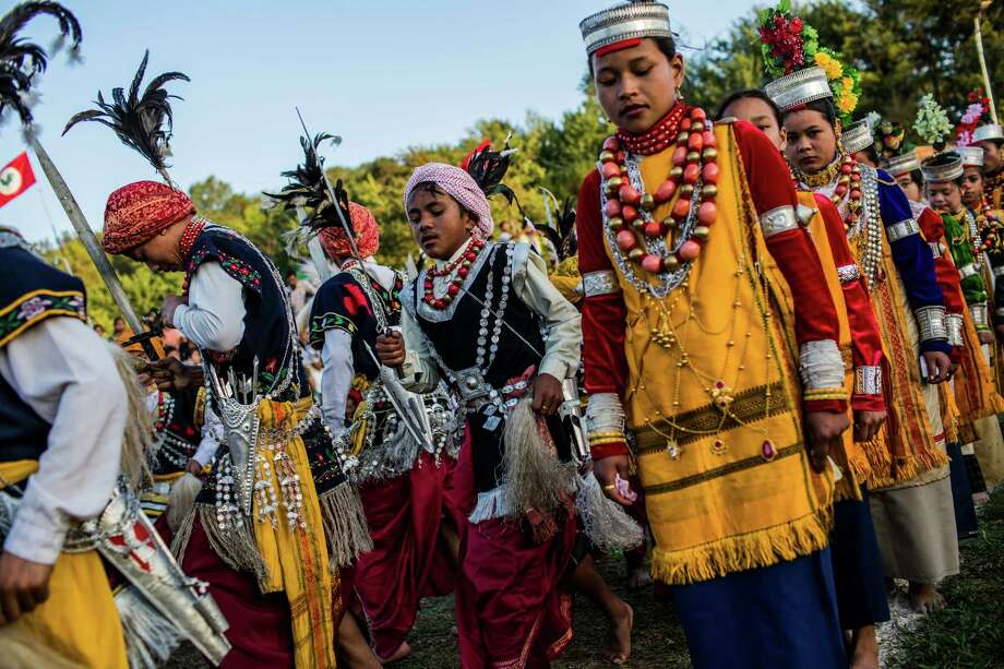 Tribal Khasi maidens and young men dressed in traditional costume participate in dance during the Shad Suk Mynsiem Festival on April 16, 2012 in Shillong, Meghalaya. Shad Suk Mynsiem, literally meaning, Dance of the joyful soul, is one of the most important festivals of the Khasis, the indigenous tribe of Meghalaya's Khasi Hills. It is an annual thanksgiving dance festival, when people of the Khasis tribes offer prayer to God for a bumper harvest. The maidens dressed in expensive silk costumes with heavy gold, silver and coral ornaments dance in the inner circle of the arena. The men form an outer circle and dance to the accompaniment of traditional music. The festival lasts for three days. Photo: Daniel Berehulak, Getty Images / 2012 Getty Images