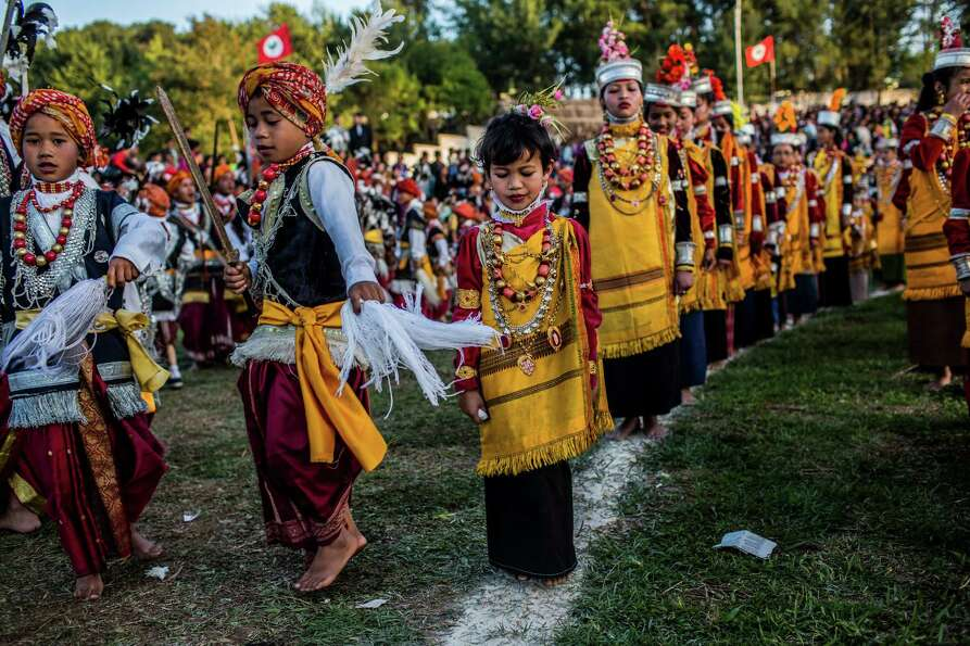 Tribal Khasi maidens and young men dressed in traditional costume participate in dance during the Sh