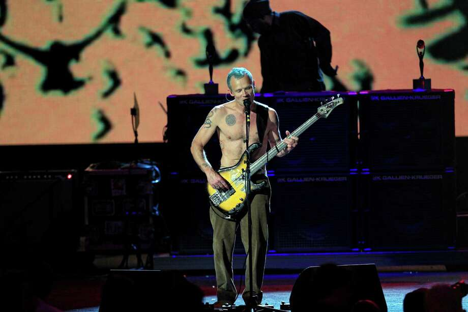 "Red Hot Chili Peppers' Mike ""Flea"" Balazary performs after induction into the Rock and Roll Hall of Fame Sunday, April 15, 2012, in Cleveland. (AP Photo/Tony Dejak) Photo: Tony Dejak, Associated Press / AP"