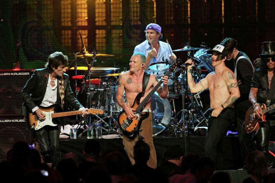 """Ronnie Wood, left, Mike """"Flea"""" Balazary, second from left, Chad Smith and Anthony Kiedis, right, perform in the finale to the 2012 Rock and Roll Hall of Fame inductions Sunday, April 15, 2012, in Cleveland. (AP Photo/Tony Dejak) Photo: Tony Dejak, Associated Press / AP"""