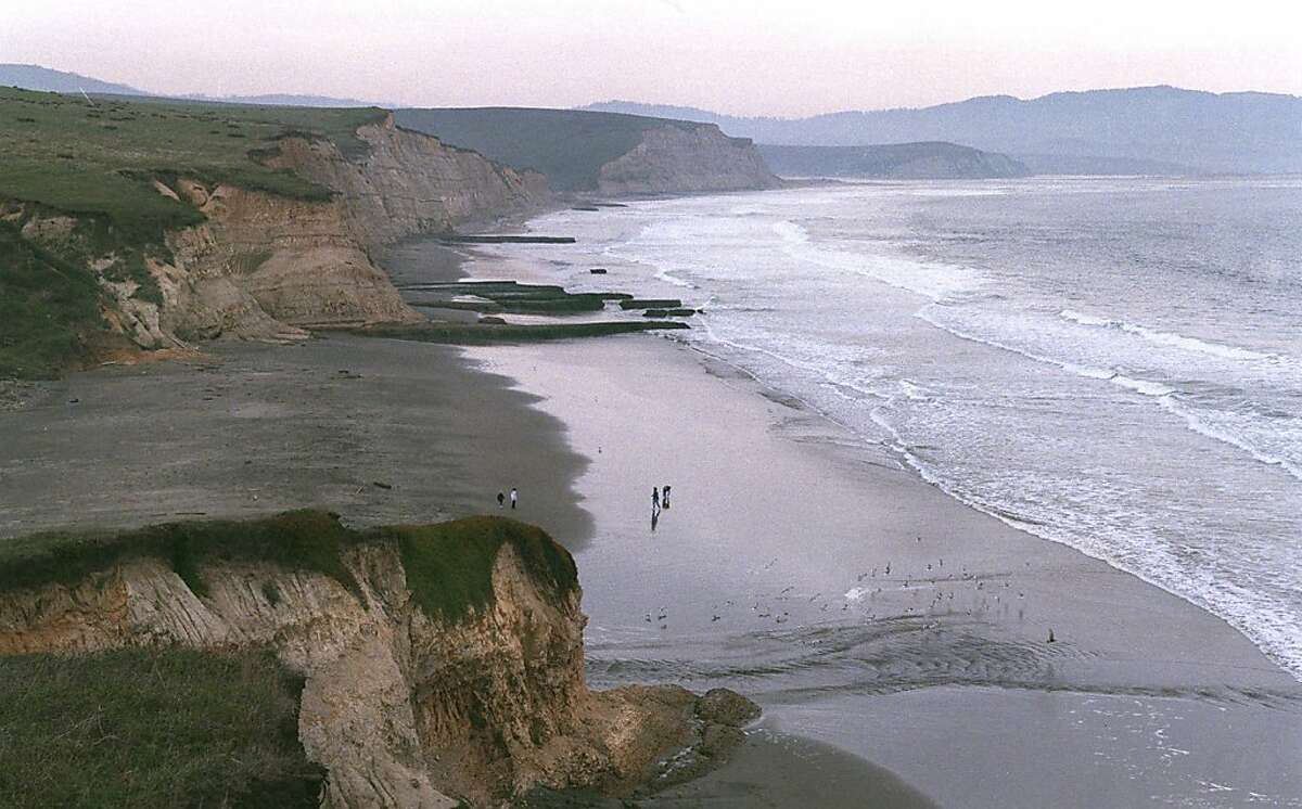 In this photo taken on Feb. 13, 1999 photo, visitors take in the view from the bluff along Drake's Beach at Point Reyes National Seashore, Calif.