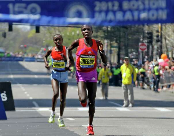 Winner Sharon Cherop of Kenya beats second-placed compatriot Jemimia Jelegat Sumgong  to the finish line of the 2012 Boston Marathon in Boston, Monday, April 16, 2012. Photo: Elise Amendola