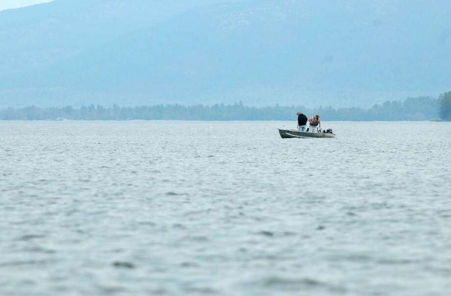 Two men fish from a boat on Lake George on Monday, April 16, 2012 in Lake George, NY.  (Paul Buckowski / Times Union) Photo: Paul Buckowski