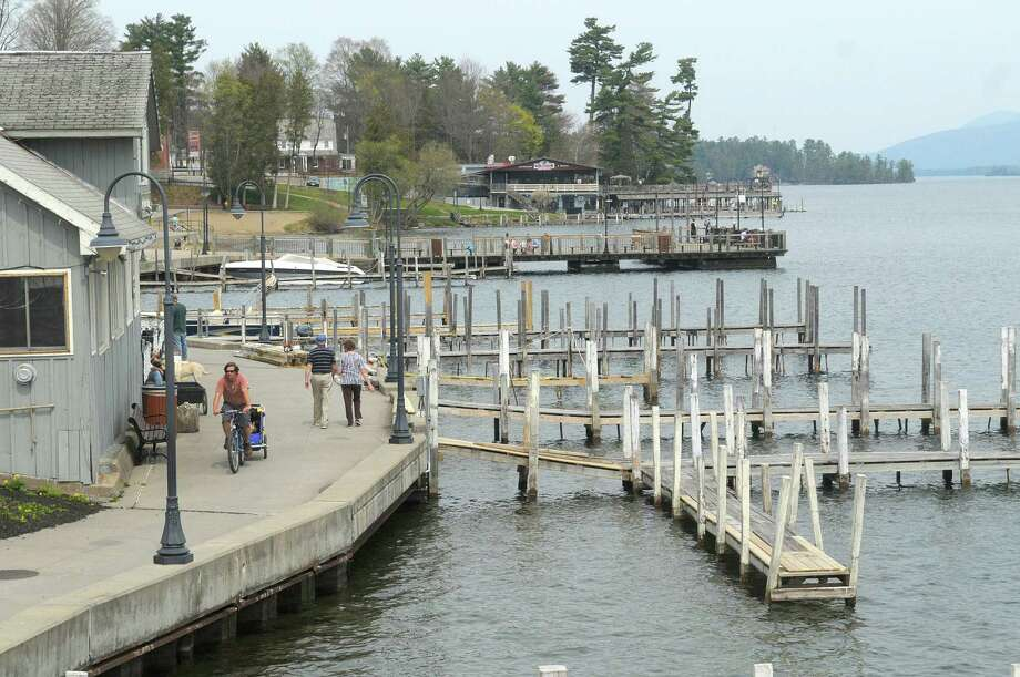 People make their way along the west side of Lake George past the restaurants and shops on Monday, April 16, 2012 in Lake George, NY.  (Paul Buckowski / Times Union) Photo: Paul Buckowski