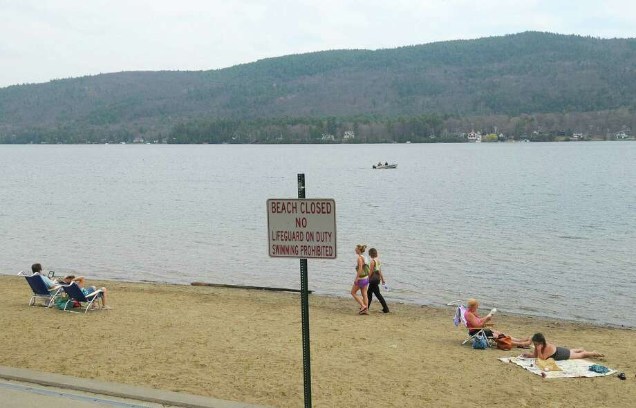 People get out to enjoy the warm temperatures and plenty of space on the town beach on Monday, April 16, 2012 in Lake George, NY.  (Paul Buckowski / Times Union) Photo: Paul Buckowski