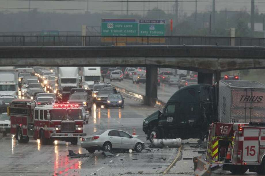 Police investigate an accident on the Katy Freeway at Shepherd on Monday, April 16, 2012. (Johnny Hanson/Chronicle)