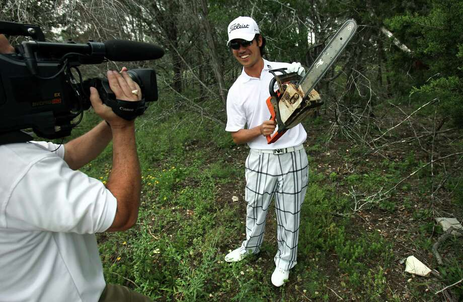 Kevin Na, wields a chain saw during the Golf Channel's taping of him revisiting the 9th hole at TPC San Antonio where last year he made a record-setting 16 at last year's Valero Texas Open.  He was also asked to play the same hole with just a 6-iron from tee to cup. He made a 5 on the par 4, 11 strokes better than last year's 16. Monday, April 16, 2012.  Bob Owen/San Antonio Express-News. Photo: BOB OWEN, San Antonio Express-News / © 2012 San Antonio Express-News