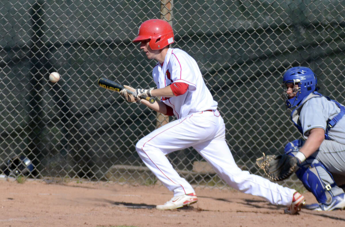 Greenwich's David Berdoff (6) bunts during the baseball game against Wilton at Greenwich High School on Monday, Apr. 16, 2012.