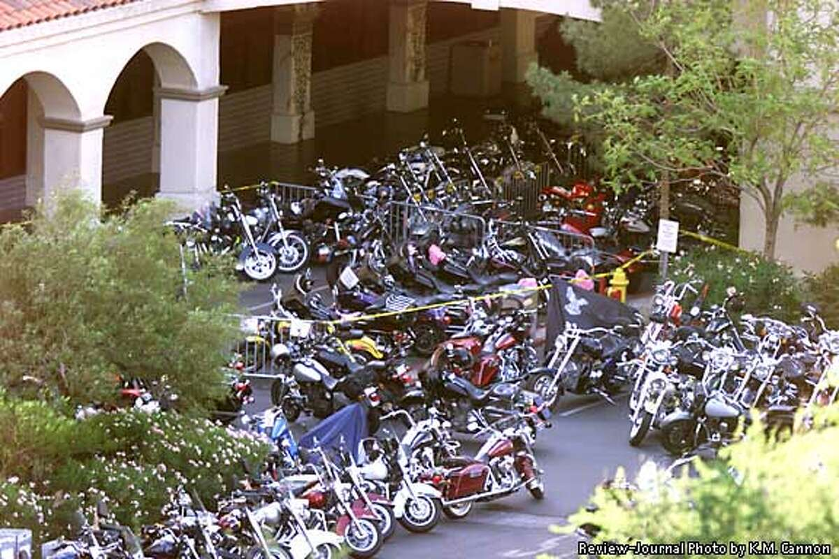 Motorcycles are parked outside Harrah's Casino in Laughlin, Nev., Saturday, April 27, 2002, the scene of a shooting between rival motorcycle gangs that left three dead, police said. It was the worst shooting ever inside a Nevada casino. (AP Photo/Las Vegas Review-Journal, K.M. Cannon)