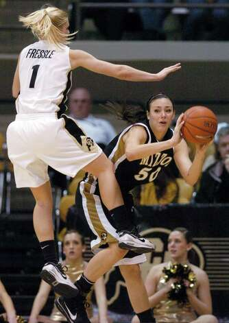 Colorado's Alyssa Freesle, left, plays defense on Missouri's Christine Flores in the first half of an NCAA college basketball game Saturday, Jan. 9, 2010, in Boulder, Colo. (AP Photo/The Daily Camera, Cliff Grassmick) ** THE LONGMONT DAILY TIMES CALL OUT; COLORADO DAILY OUT; EXAMINER.COM OUT ** Photo: AP