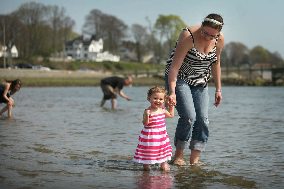 Maci Warzecha, 1 of Naugatuck, takes her first ever walk in the shallows of the Sound with mom Kiera DaSilva at Gulf Beach in Milford on Monday, April 16, 2012. Photo: Brian A. Pounds / Connecticut Post