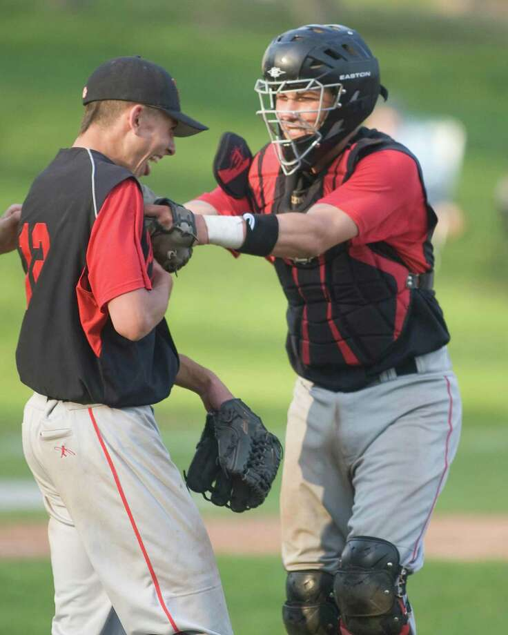 Pomperaug's David Cherry receives congratulations from catcher Matt Calzone after pitching a no-hitter against Immaculate Monday in Danbury. Photo: Barry Horn / The News-Times Freelance