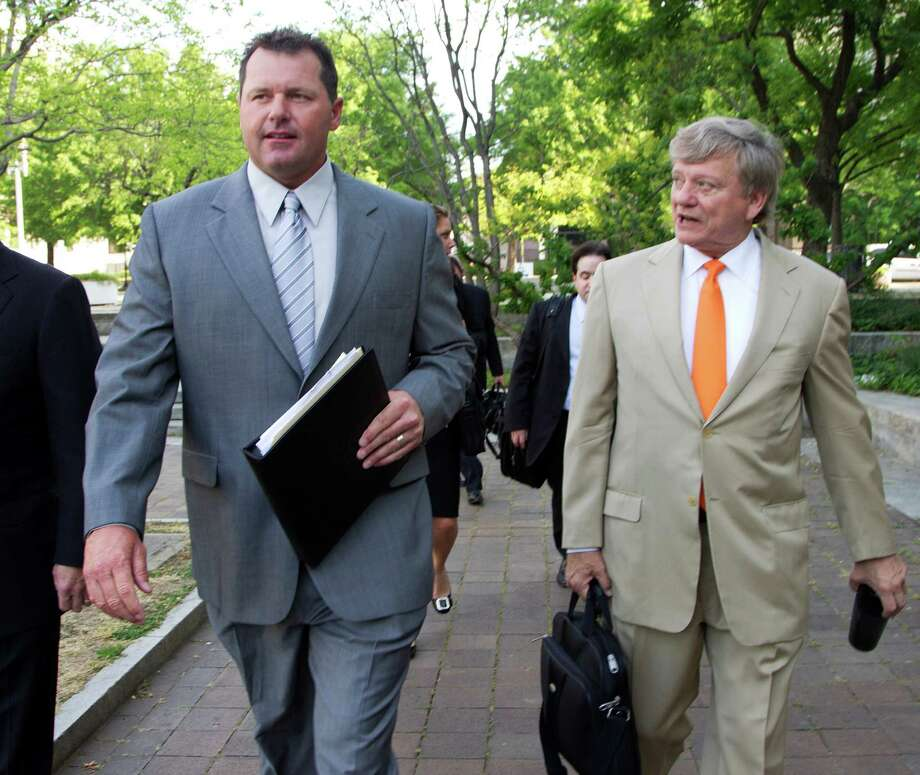 Roger Clemens, left, appeared relaxed Monday as he arrived at court with his attorney, Rusty Hardin. Photo: Manuel Balce Ceneta / AP