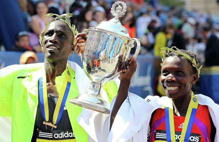 Wesley Korir, left, and Sharon Cherop, both of Kenya, are all smiles after winning the men's and women's titles in the 116th Boston Marathon on Monday. Photo: Jim Rogash / 2012 Getty Images