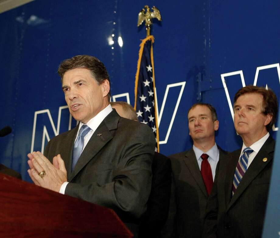 Texas Governor Rick Perry left, as he announces the Texas Budget Compact, composed of five key principles during a press conference as Empower Texans President and CEO Michael Quinn Sullivan center, and Texas State Senator Dan Patrick look on at New World Van Lines Monday, April 16, 2012, in Houston. Photo: James Nielsen, Chronicle / © 2012 Houston Chronicle