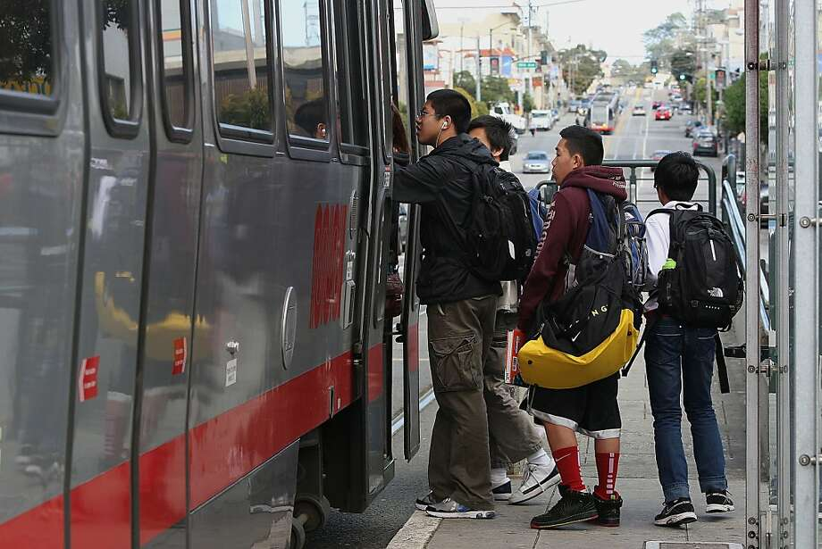 Lincoln High School students catching the bus after school on Taravel St. at 19th Ave. in San Francisco, Calif., on Friday, April 13, 2012.  An SFMTA (San Francisco Municipal Transportation Agency) proposal for free Muni for youth will be considered by the MTA board early next week. Photo: Liz Hafalia, The Chronicle