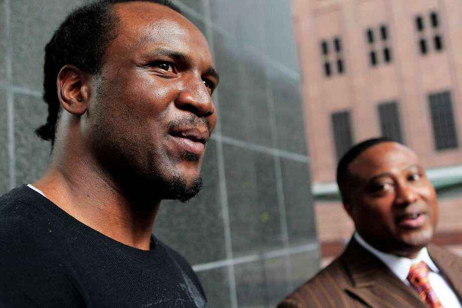 Yondell Johnson, left, and local activist Quanell X address the media outside the Bob Casey Federal Courthouse after the four white men that were charged through Harris County with the misdemeanor assault of Johnson in August have now had their crimes moved to the federal court as a hate crime Thursday, Jan. 19, 2012, in Houston.  Johnson and Quanell X contend that the Harris County District Attorney's office should have made the charges a hate crime from the start. ( Johnny Hanson / Houston Chronicle ) Photo: Johnny Hanson / © 2012  Houston Chronicle