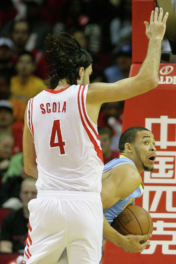 Houston Rocket Luis Scola pressures Denver Nuggets center JaVale McGee, right, during the first half of a basketball game at the Toyota Center Monday, April 16, 2012, in Houston. Photo: Cody Duty, Houston Chronicle / © 2011 Houston Chronicle