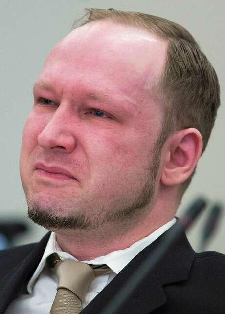 Norwegian Anders Behring Breivik, who is facing terrorism and premeditated murder charges, reacts as a video presented by the prosecution is shown in court, Oslo, Norway, Monday, April 16, 2012. Breivik, who confessed to killing 77 people in a bomb-and-shooting massacre went on trial in Norway's capital Monday, defiantly rejecting the authority of the court. (AP Photo/Heiko Junge, Pool) Photo: Heiko Junge / POOL SCANPIX NORWAY