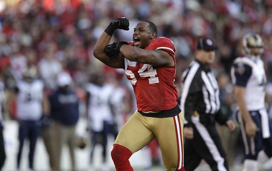 San Francisco 49ers linebacker Larry Grant (54) celebrates after tackling St. Louis Rams running back Steven Jackson during the fourth quarter of an NFL football game in San Francisco, Sunday, Dec. 4, 2011. Photo: Paul Sakuma, AP