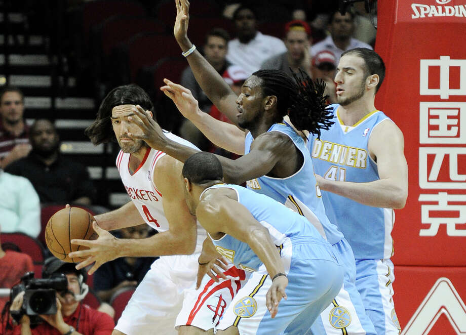 Luis Scola works against Denver Nuggets' Arron Afflalo, front, Kenneth Faried, center, and Kosta Koufos during the first half of an NBA basketball game Monday, April 16, 2012, in Houston. Photo: Pat Sullivan, Associated Press / AP
