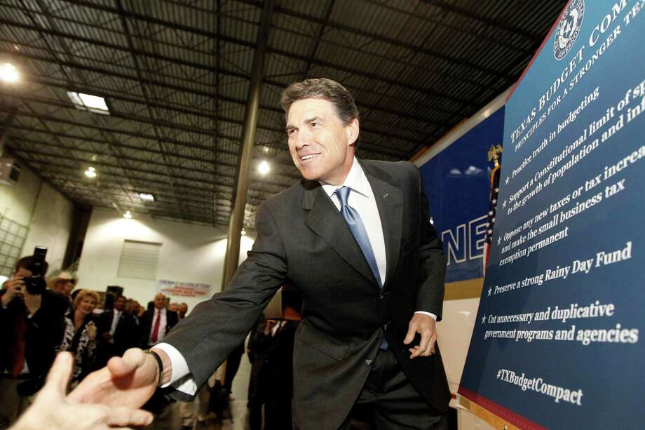 Gov. Rick Perry announces his Texas Budget Compact, made up of five key principles, at New World Van Lines in Houston. Photo: James Nielsen / © 2012 Houston Chronicle