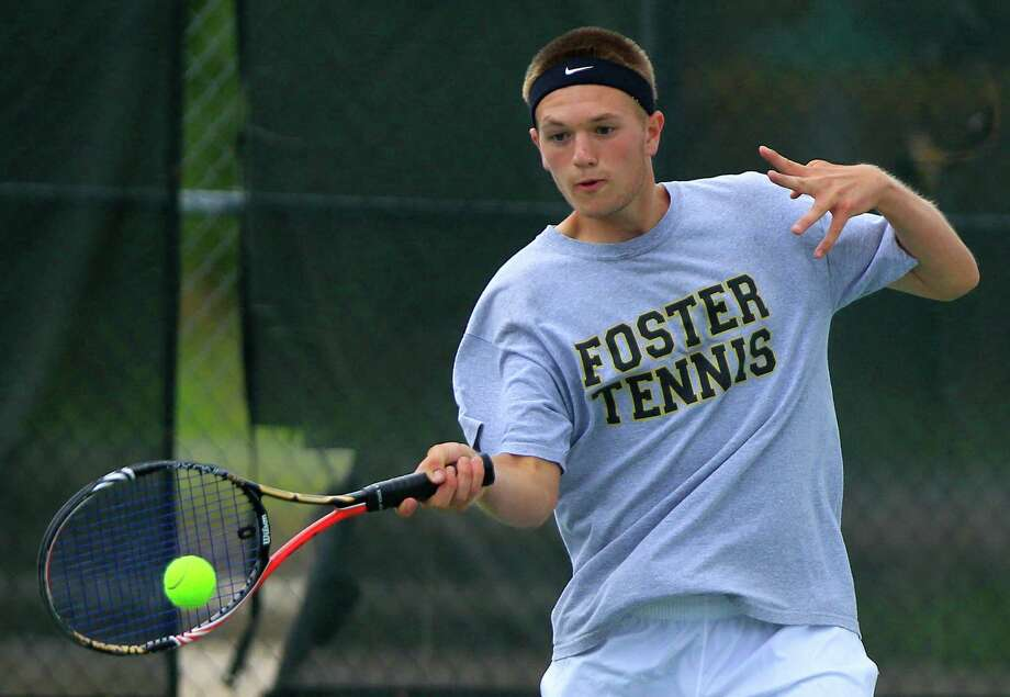 Foster High School's Trevor Kipping returns a serve during Monday's play in the Class 4A Region III tennis tournament at Willis. Kipping and Paige Boykin advanced to the semifinals in mixed doubles. Photo: Cody Duty / © 2011 Houston Chronicle