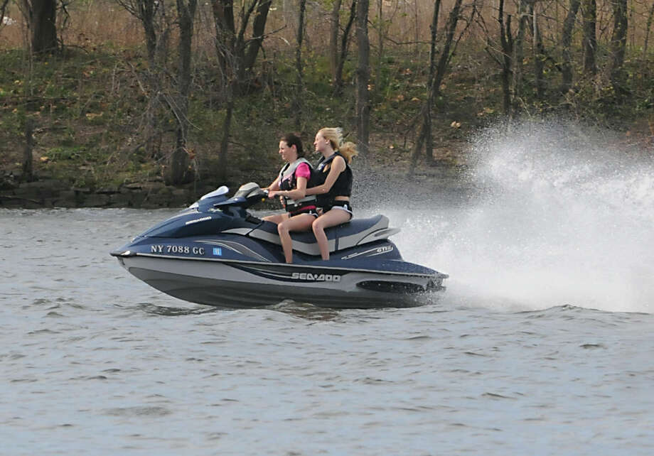 Two girls enjoy the warm Spring day by jet skiing on the Hudson River on April 16, 2012 in  Albany N.Y. (Lori Van Buren / Times Union) Photo: Lori Van Buren