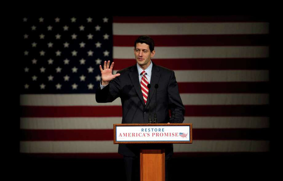 FILE - In this March 30, 2012 file photo, House Budget Committee Chairman Rep. Paul Ryan, R-Wis. speaks at Lawrence University in Appleton, Wis. Days into his new role as presumptive Republican presidential nominee, Mitt Romney has initiated a months-long search for a running mate, an effort to be guided as much by his methodical corporate-based approach as the shadows of Sarah Palin. (AP Photo/Steven Senne, File) Photo: Steven Senne