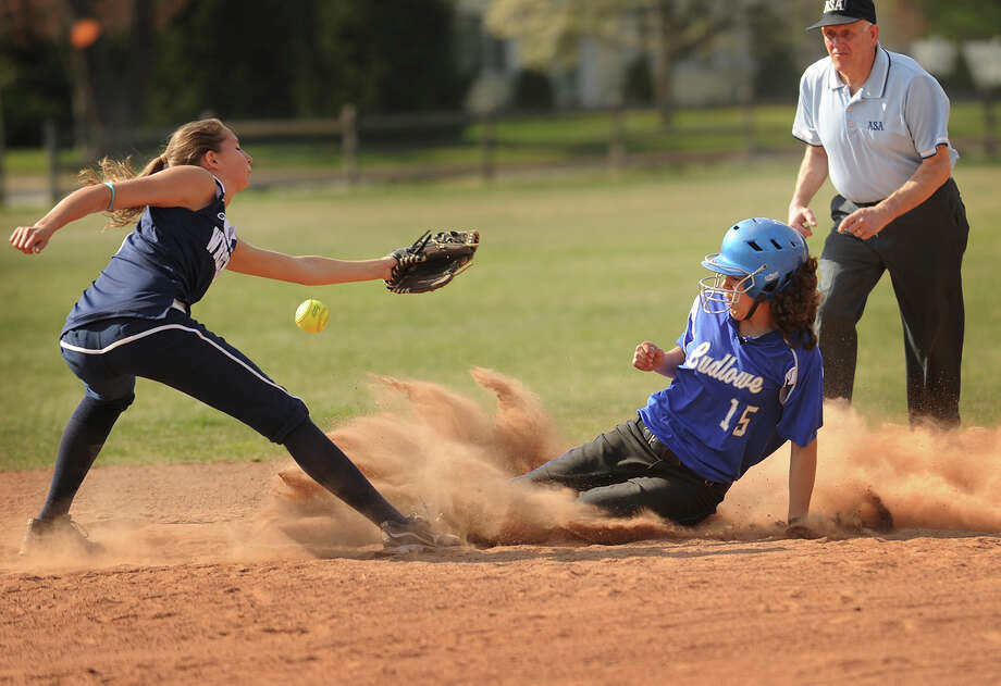 Fairfield Ludlowe's Gillian Kennedy steals second base as the throw gets past Staples shortstop Nikki Bukovsky during the first inning of their FCIAC girls softball matchup at Sturges Park in Fairfield on Monday, April 16, 2012. Photo: Brian A. Pounds / Connecticut Post