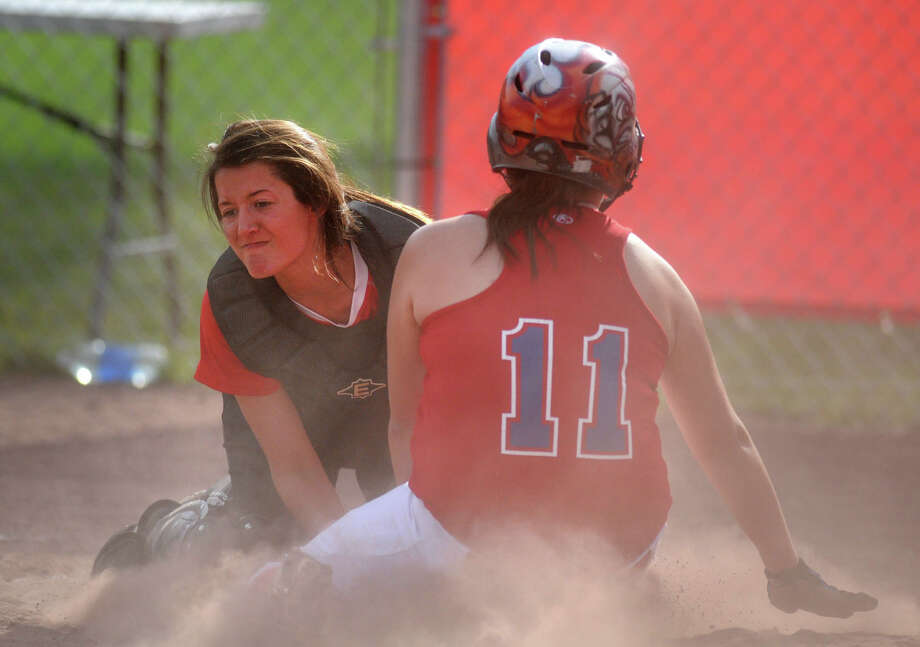 Sierra Pizzola, #11, injures herself sliding into home covered by Chatham's Leah Layton during a softball game on April 16, 2012 in Schodack, N.Y. (Lori Van Buren / Times Union) Photo: Lori Van Buren