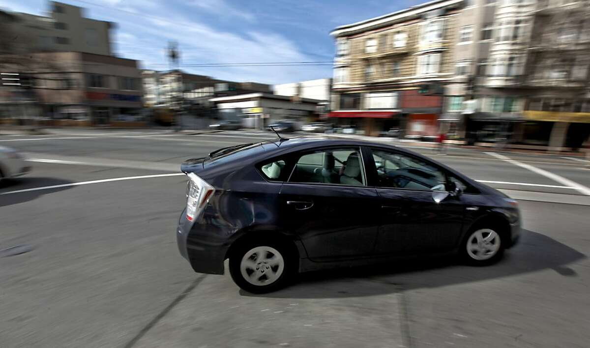 A 2010 Toyota Prius turns onto Market Street at Gough Street on Wednesday February 3, 2010, in San Francisco,Calif. While Toyota dealers scramble to deal with a gas pedal recall they now have to contend with braking issues on 2010 Prius models.