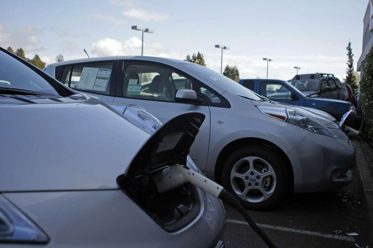 A couple of Nissan Leafs at the North Bay Nissan dealership in Petaluma, Calif., recharge their battery power at one of the electric car charging stations on Thursday, March 22, 2012 .