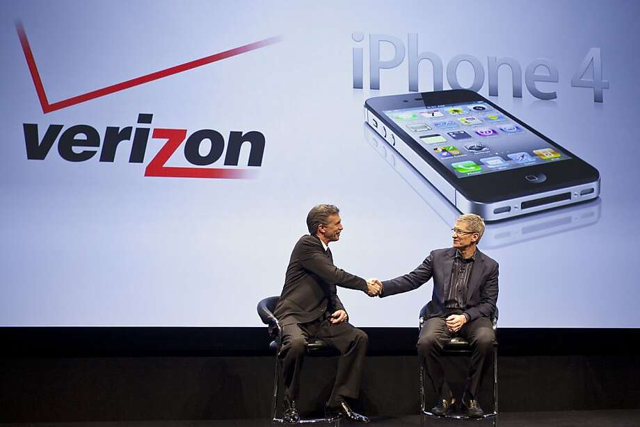 Dan Mead, chief executive officer of Verizon Wireless, left, shakes hands with Timothy Cook, chief operating officer of Apple Inc., during an event to announce that Verizon will start selling a version of Apple Inc.'s iPhone in New York, U.S., on Tuesday, Jan. 11, 2011. Verizon Wireless will start selling Apple Inc.'s iPhone early next month, ending rival AT&T Inc.'s exclusive hold on the device in the U.S. and more than doubling the potential customer base for the touch-screen smartphone. Photographer: Ramin Talaie/Bloomberg *** Local Caption *** Dan Mead; Timothy Cook Photo: Ramin Talaie, Bloomberg