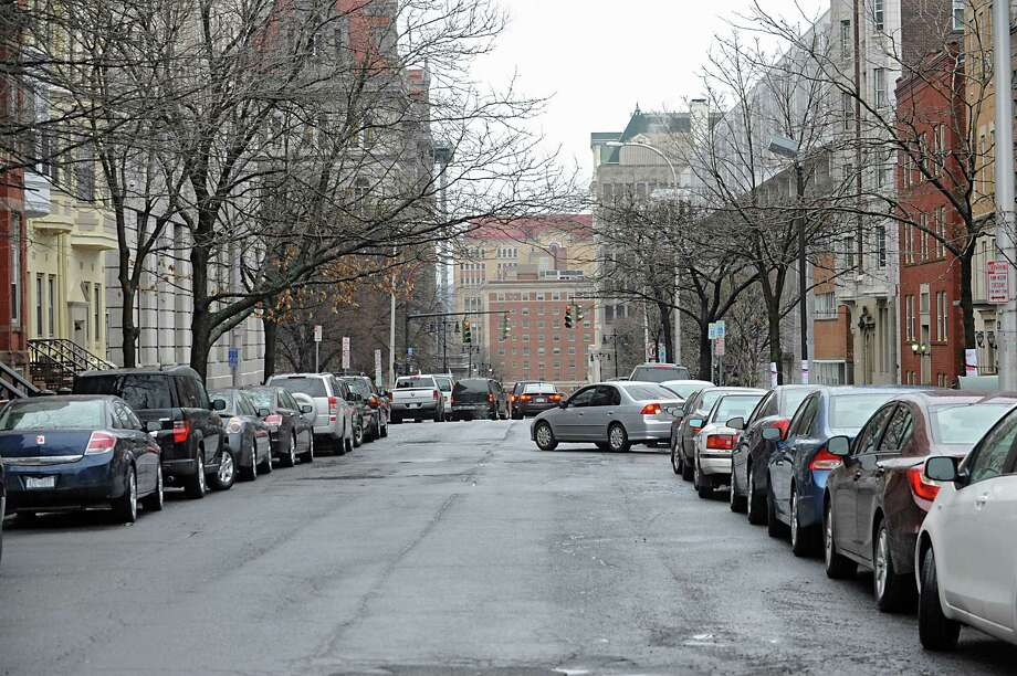 A car finds a rare parking spot along State St. Friday Jan. 27, 2012 in Albany, N.Y.  Albany's Common Council is ready to schedule a vote on the creation of the long-desired parking permit system. (Lori Van Buren / Times Union) Photo: Lori Van Buren / 00016247A