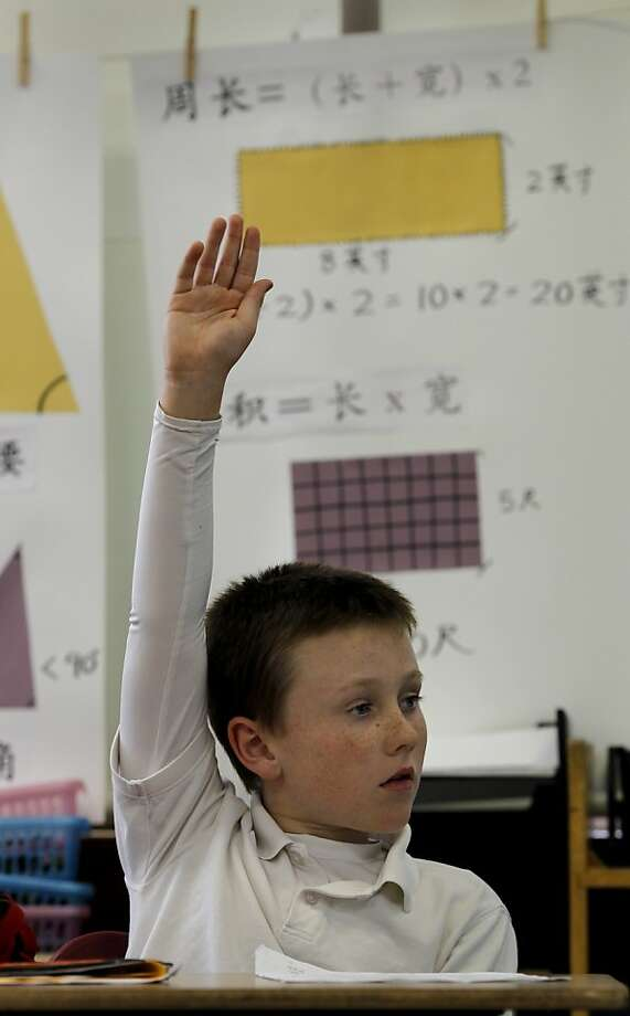 Jack Gaughan raises his hand to answer a math question in his Mandarin class. Starr King Elementary School in San Francisco, Calif. began a Mandarin language immersion program six years ago.  Now the first class is graduating this spring. Photo: Brant Ward, The Chronicle
