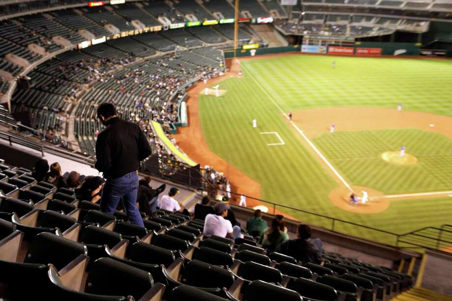 In years past, A's management reduced the size of the Coliseum by placing tarps over the seats in the third level except for a small section behind home plate. Photo: Carlos Avila Gonzalez / Carlos Avila Gonzalez / The Chronicle / SFC