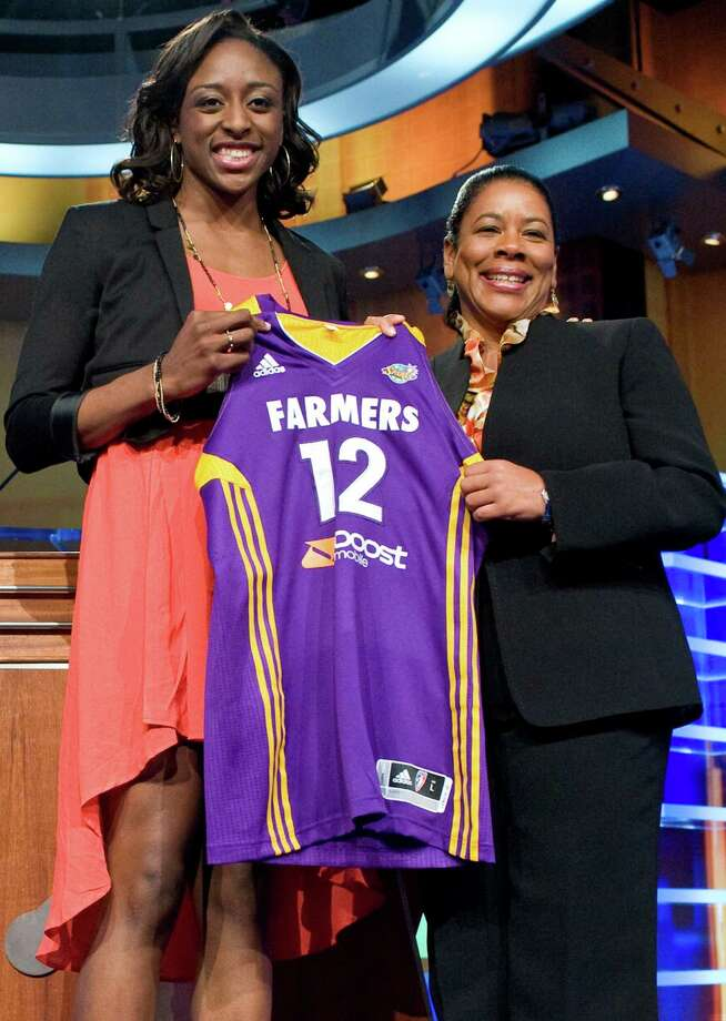 Stanford's Nnemkadi Ogwumike, left, holds up a Los Angeles Sparks jersey with WNBA president Laurel J. Richie after the Sparks selected Ogwumike as the No. 1 pick in the WNBA basketball draft in Bristol, Conn., Monday, April 16, 2012.  (AP Photo/Jessica Hill) Photo: Jessica Hill / AP2012