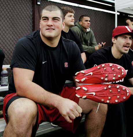 Stanford guard David DeCastro puts on his shoes during Stanford's NFL football pro day on the Stanford University campus in Stanford, Calif., Thursday, March 22, 2012. (AP Photo/Paul Sakuma) Photo: Paul Sakuma / AP