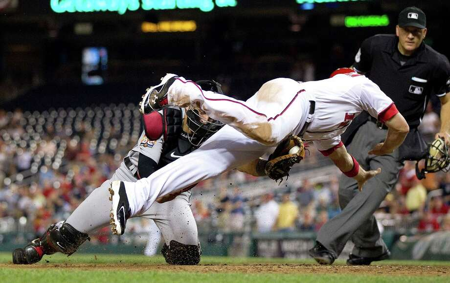 Washington's Ryan Zimmerman (11) is tagged out at home plate by Astros catcher Jason Castro (15) in the eighth inning. Photo: Harry E. Walker / McClatchy-Tribune Photo Service 2009