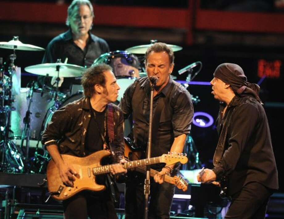 Bruce Springsteen performs to a sold out crowd at the Times Union Center on April 16, 2012 in Albany, N.Y. His original E-Street Band members Nils Lofgren, left, Steve Van Zandt, right, and Max Weinberg on drums back him up well. (Lori Van Buren / Times Union) (Albany Times Union)
